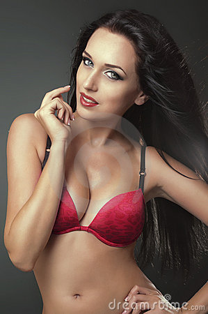 Sexy brunette woman in red bra