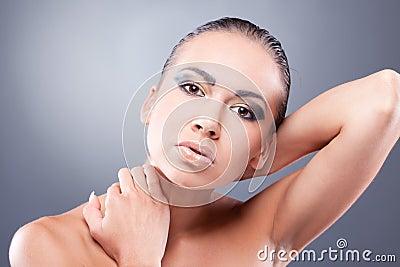 Sexy brunette woman touching neck