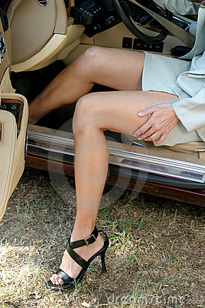Sexy Business Woman Getting Out of Car 2