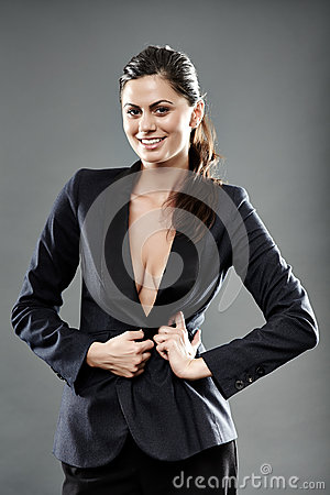 Sexy businesswoman with suit over nude breasts