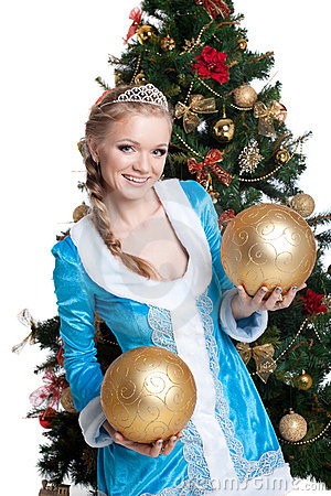 Sexy christmas girl smile and hold gold balls