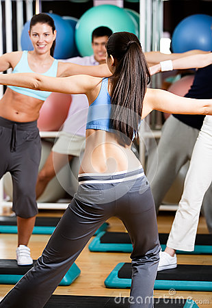 Sexy coach exercises with her group