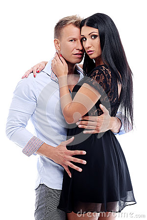 Sexy couple having a photo session in studio
