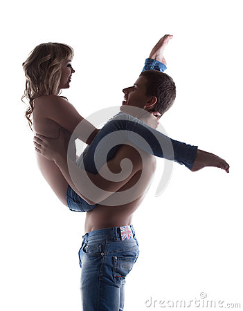 Sexy couple posing topless in jeans silhouette