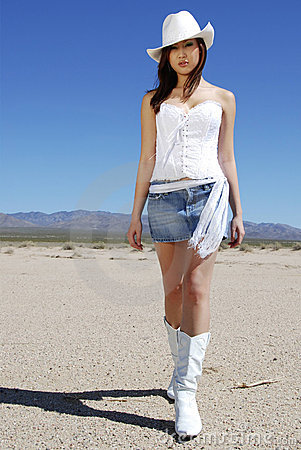 Free Sexy Cowgirl Walking Royalty Free Stock Photography - 2179417