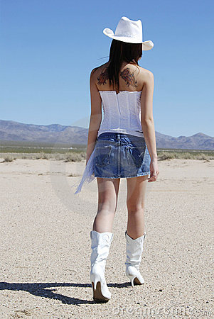 Free Sexy Cowgirl Walking Away Stock Photo - 2179450