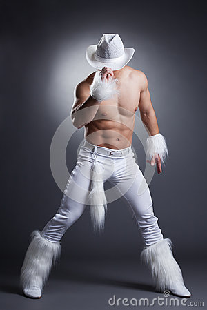 Sexy dancer in white cowboy costume