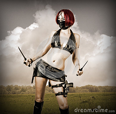 Sexy dangerous woman in black mask