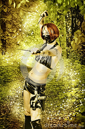 Sexy dangerous woman in magic forest