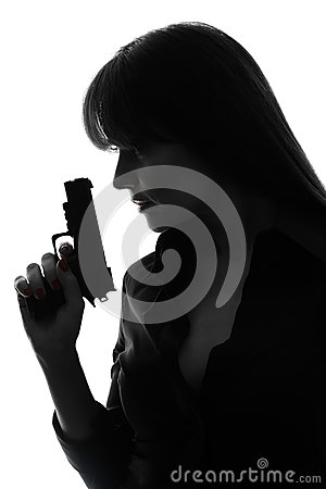 Sexy detective  woman holding  gun silhouette