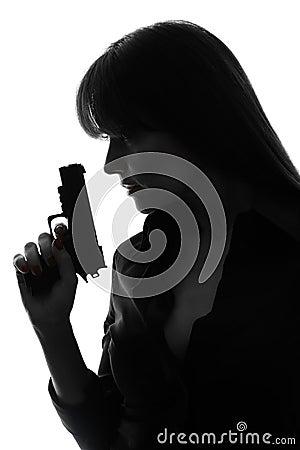 Sexy detective  woman holding  gun silhouette