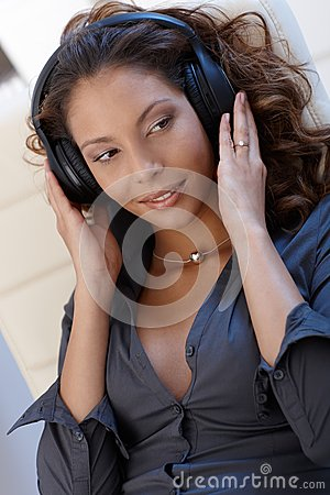 Sexy ethnic woman with headphones