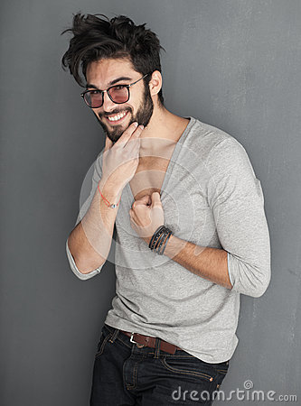 Sexy fashion man with beard dressed casual smiling
