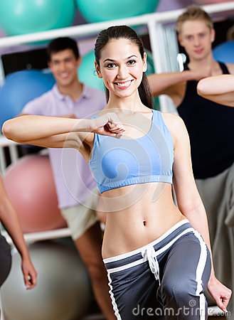Sexy female coach trains with her group