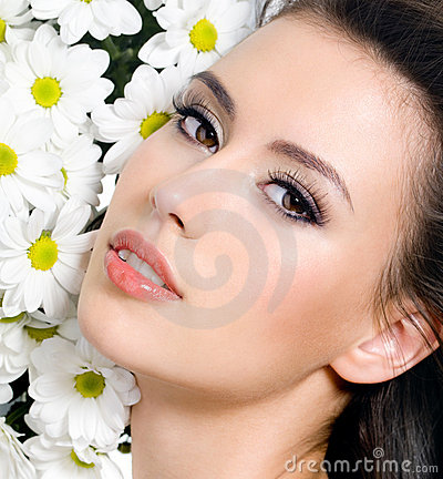 Sexy female face with flowers