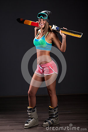 Free Sexy Female In Ski Costume Posing With Skis In Studio On Dark Ba Royalty Free Stock Image - 79071746