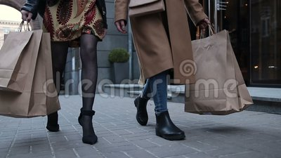 female legs walking on shopping street stock video