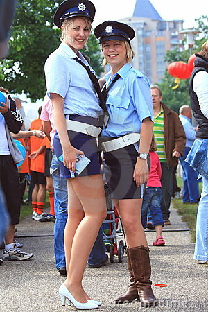 Sexy female police officers in the street Editorial Stock Image