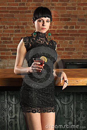 Sexy female standing at a bar