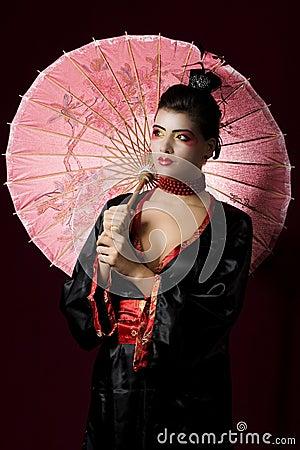 Sexy geisha wearing a traditional kimono