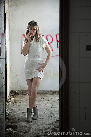 Sexy girl in abandoned building