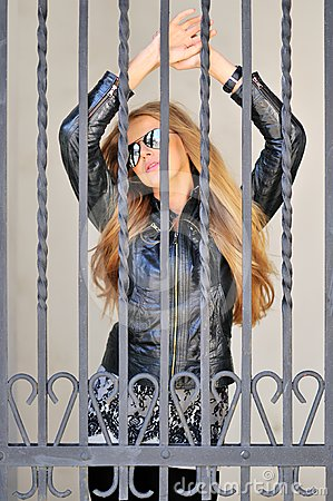 Sexy girl behind bars