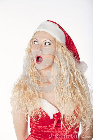 Sexy girl with blonde curly hair dressed as Santa
