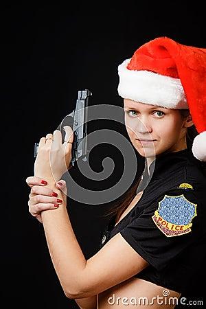 Sexy girl cop with a gun