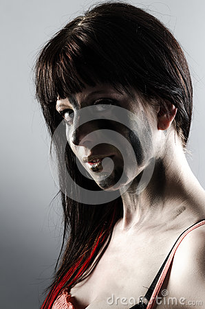 Sexy girl with dark streaks on her face and neck