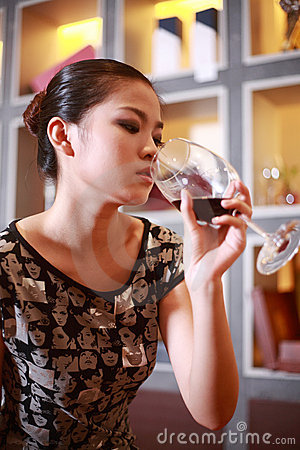 Sexy girl drinking wine