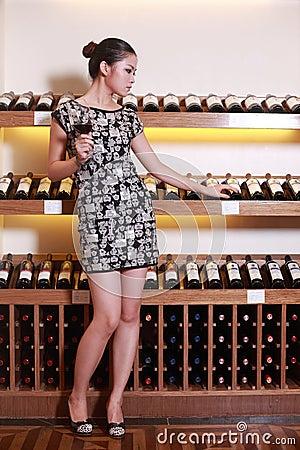 Sexy girl drinking wine