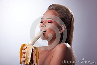 Sexy girl eat long banana with desire