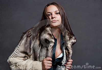 Sexy girl in fur coat