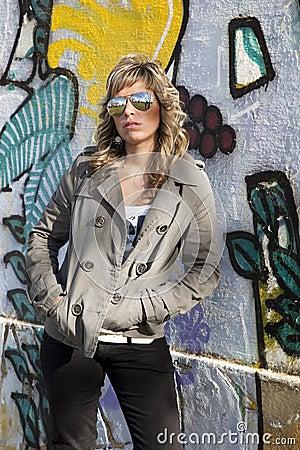 Sexy girl in graffiti wall
