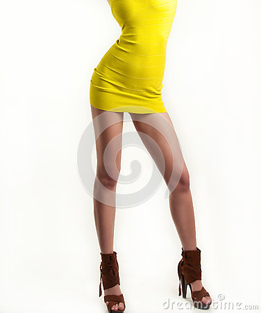 Free Sexy Girl In Yellow Short Dress Isolated On White Background, Studio Shot.   Royalty Free Stock Images - 37721119