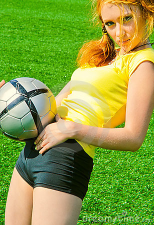 Sexy girl keeping ball