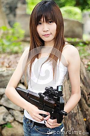 Sexy girl with machine gun