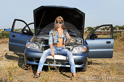 Sexy girl-mechanic near the car