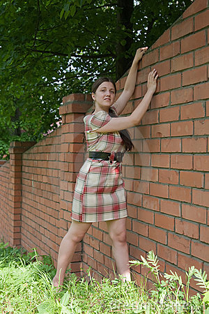 Sexy girl near brick wall