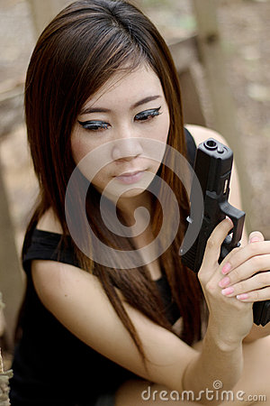 Sexy girl with pistol