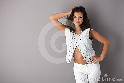 Sexy girl posing over gray background