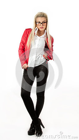 Sexy girl in red leather jacket posing in studio