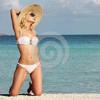 Sexy Girl relaxing on the Tropical Beach. Glamour Blonde woman