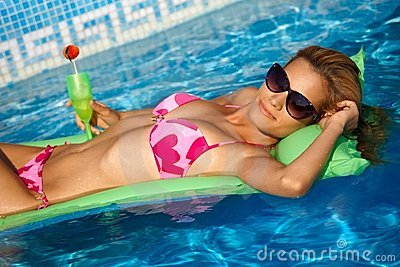 Sexy girl relaxing on water at summertime