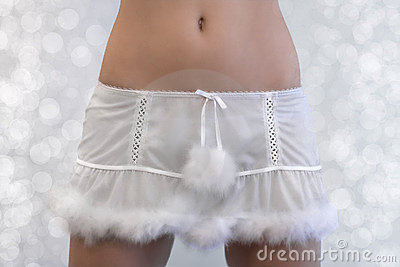 Sexy girl in a short fur trimmed xmas skirt
