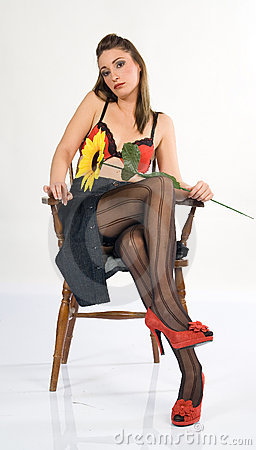 Sexy girl sitting in a chair 4