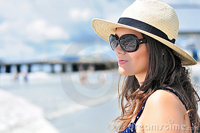 Sexy girl staring in vain at the calm ocean