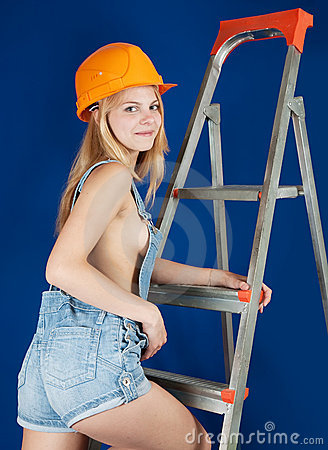 Sexy girl on stepladder over blue