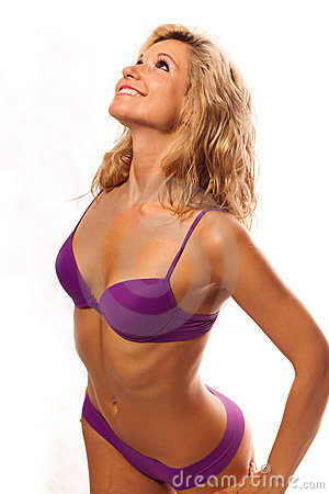 Sexy girl in a wet violet bikini