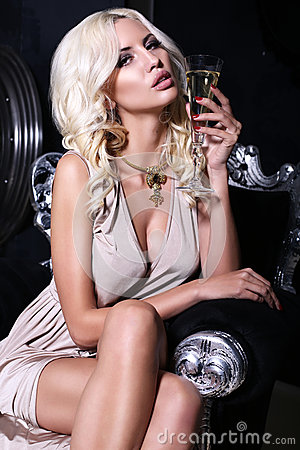 Free Sexy Girl With Blond Hair With Glass Of Champagne Stock Photo - 36760850